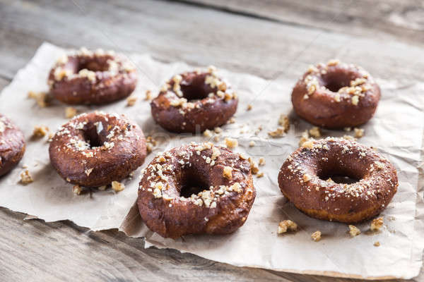 Donuts sprinkled with crushed nuts Stock photo © Alex9500