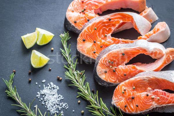 Brut truite alimentaire fond orange Photo stock © Alex9500