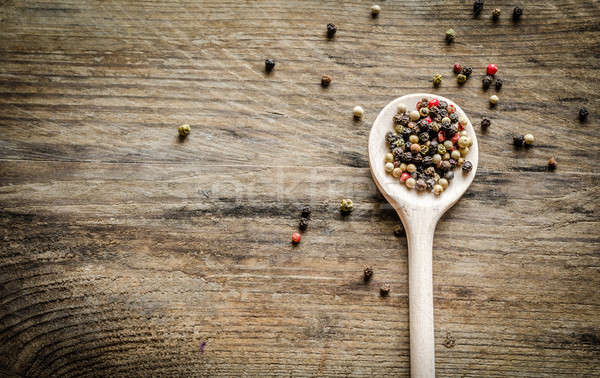Wooden spoon with pepper Stock photo © Alex9500