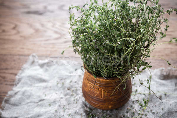 Fresh thyme on the wooden background Stock photo © Alex9500
