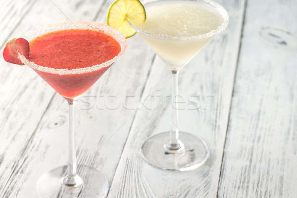 Glasses of lime and strawberry margarita cocktail Stock photo © Alex9500