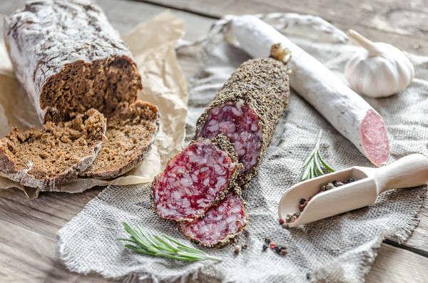 Slices of saucisson and spanish salami on the sackcloth Stock photo © Alex9500