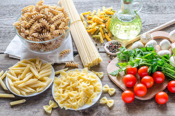 Various pasta with mushrooms and cherry tomatoes Stock photo © Alex9500