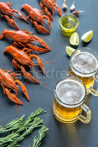 Boiled crayfish with two mugs of beer Stock photo © Alex9500