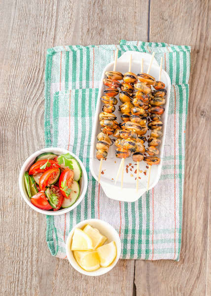 Mussel skewers with fresh salad Stock photo © Alex9500