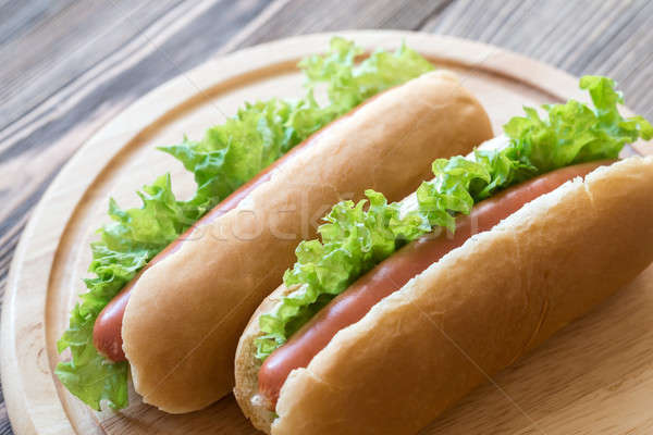 Hot dogs on the wooden board Stock photo © Alex9500