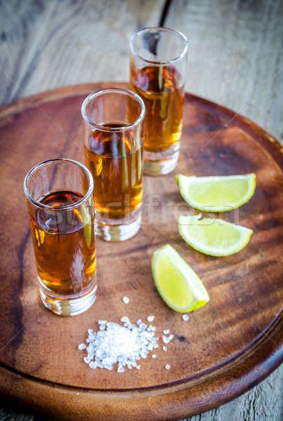 Glasses of tequila on the wooden board Stock photo © Alex9500
