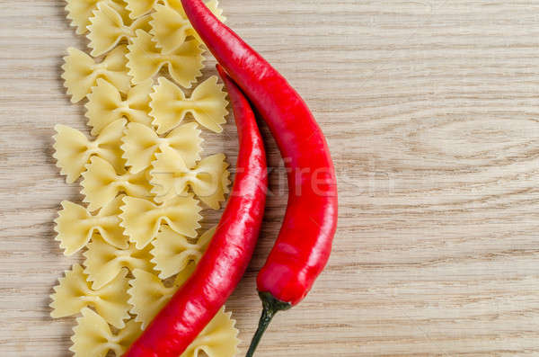 Uncooked farfalle pasta and chili peppers Stock photo © Alex9500