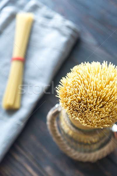 Uncooked spaghetti in the glass Stock photo © Alex9500