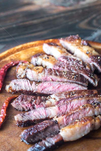 Cut beef steak on the wooden board Stock photo © Alex9500