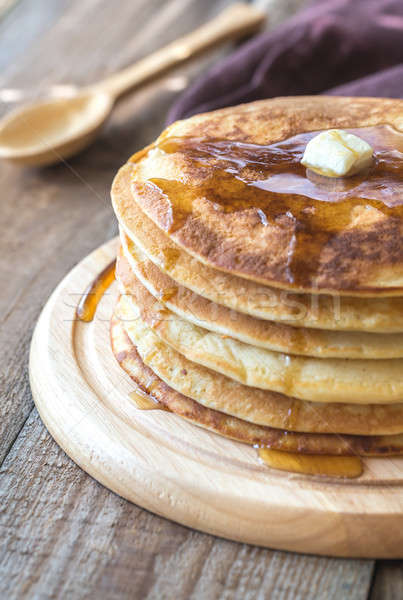 Stack of pancakes with butter and maple syrup Stock photo © Alex9500