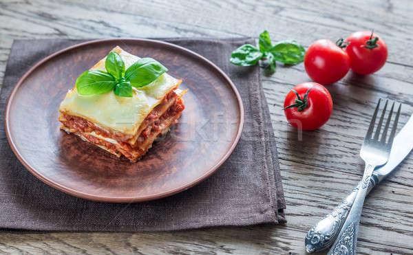 Porción clásico lasaña alimentos hoja fondo Foto stock © Alex9500