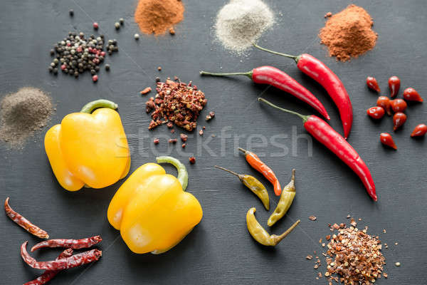 Various types of pepper on the dark wooden background Stock photo © Alex9500