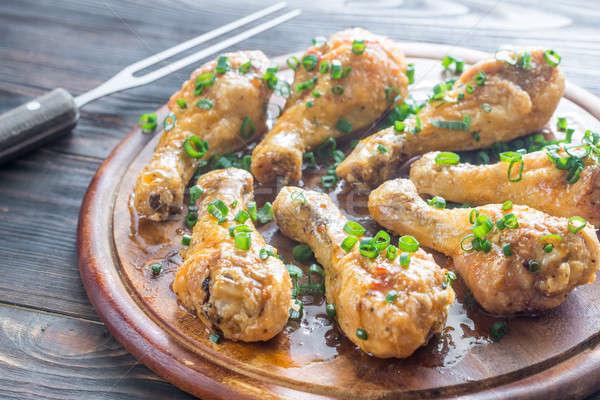 Baked chicken drumsticks Stock photo © Alex9500