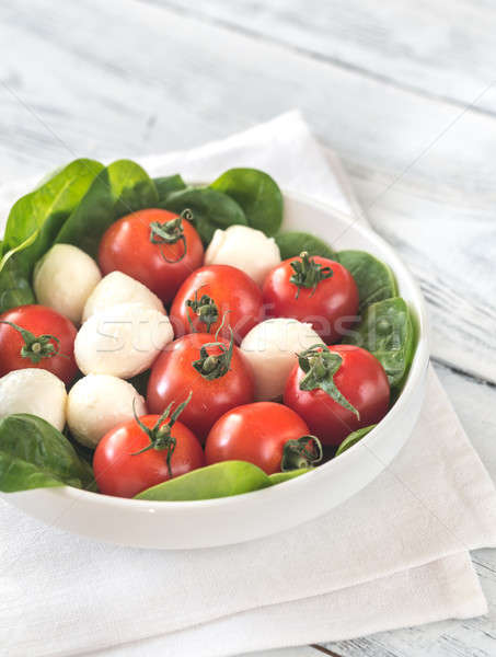 Fresh cherry tomatoes with mozzarella and spinach leaves Stock photo © Alex9500
