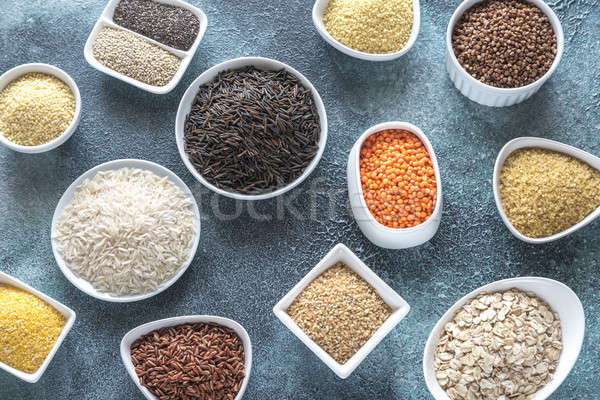 Stock photo: Assortment of grains on the gray background