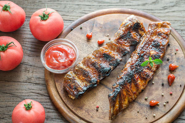 Grilled pork ribs with tomatoes on the wooden board Stock photo © Alex9500
