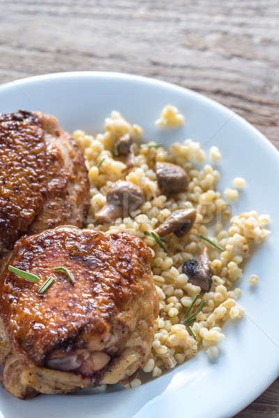 Spicy chicken with bulgur and mushrooms Stock photo © Alex9500