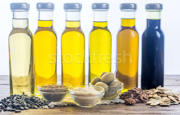 Bottles with different kinds of vegetable oil Stock photo © Alex9500