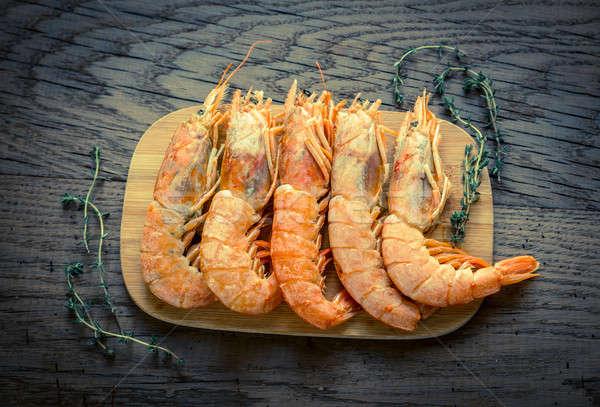 Raw shrimps with lemon wedges Stock photo © Alex9500
