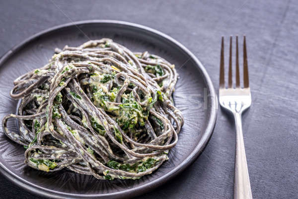 Black pasta with spinach, mascarpone and Parmesan Stock photo © Alex9500