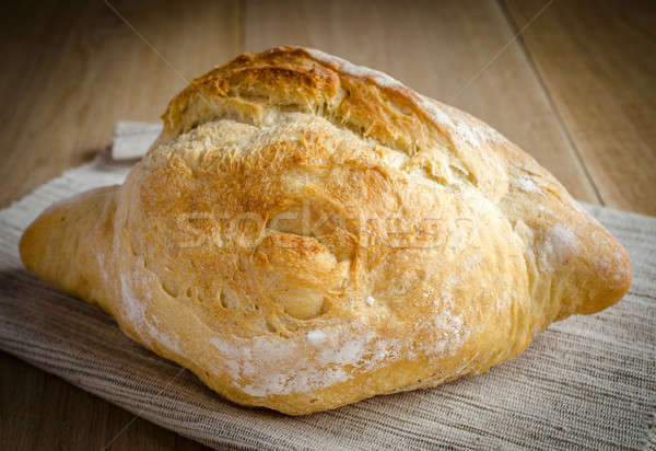 Loaf of white bread on the wooden table Stock photo © Alex9500