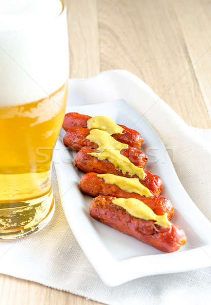Roasted sausages with glass of beer Stock photo © Alex9500