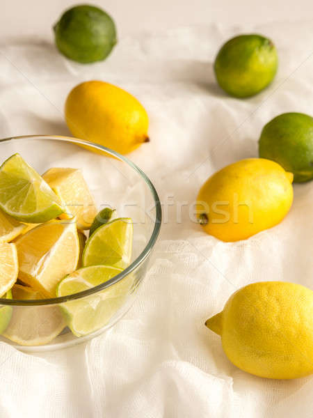 Lemons and limes on the white background Stock photo © Alex9500