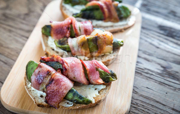 Toasts with cream cheese and avocado wrapped in bacon Stock photo © Alex9500
