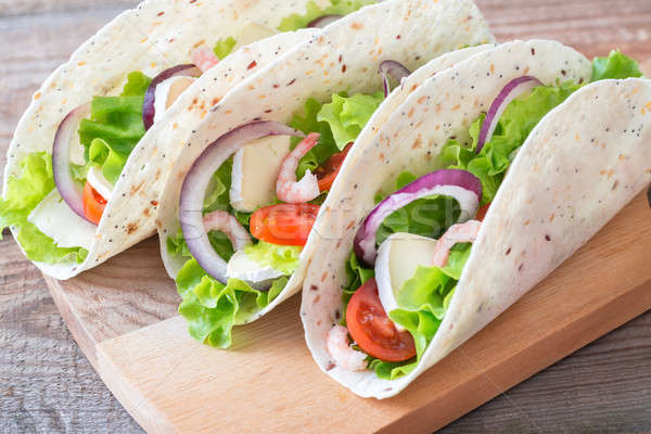 Tacos with shrimps, brie and fresh vegetables Stock photo © Alex9500
