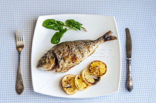 A la parrilla peces limón espinacas alimentos mar Foto stock © Alex9500