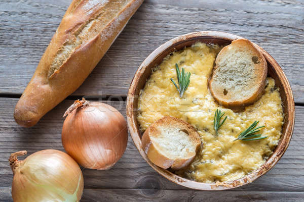 Bowl of onion soup on the wooden table Stock photo © Alex9500