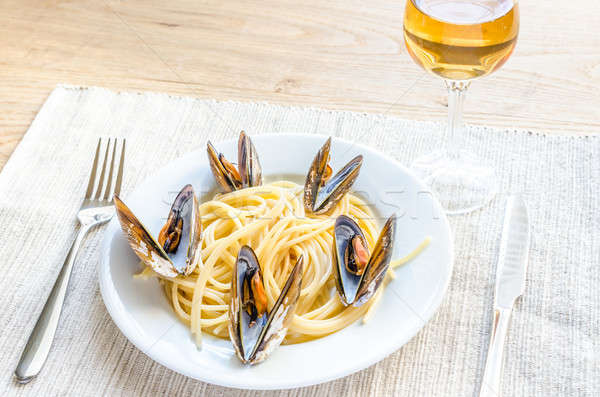 Spaghetti with mussels and cherry tomatoes Stock photo © Alex9500