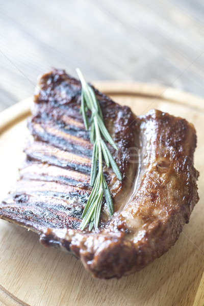 Grilled lamb ribs on the wooden board Stock photo © Alex9500