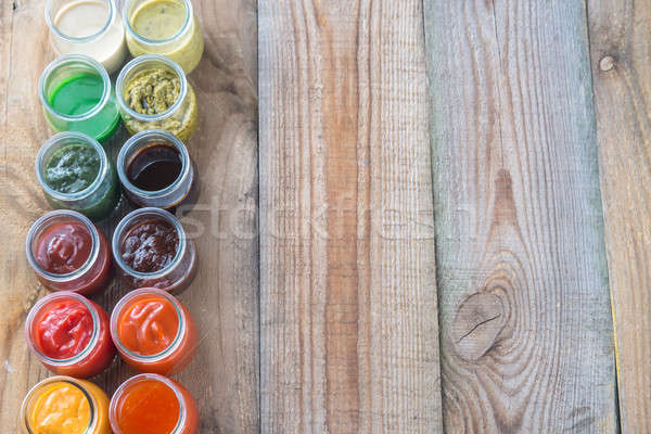 Assortment of sauces in the glass jars Stock photo © Alex9500