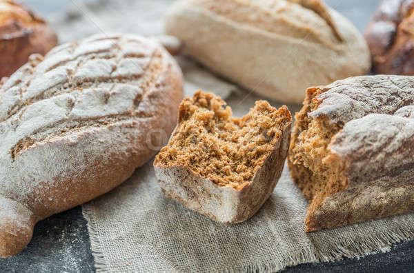 Whole grain breads on the dark wooden background Stock photo © Alex9500