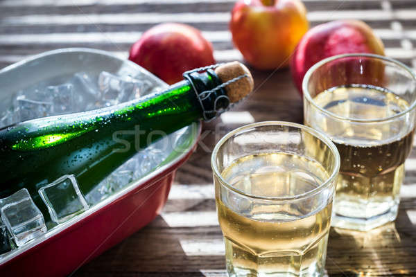 Bottle and two glasses of cider on the wooden background Stock photo © Alex9500