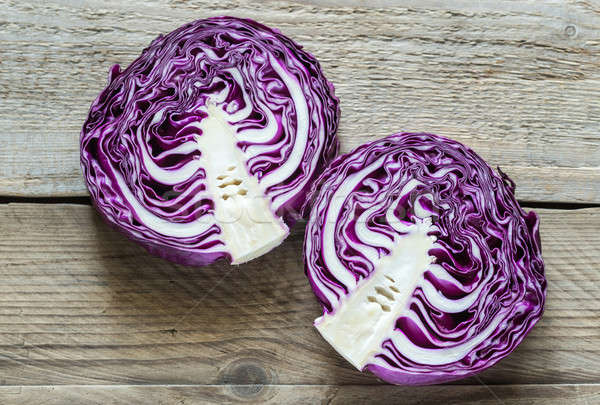 Two halves of red cabbage on the wooden background Stock photo © Alex9500
