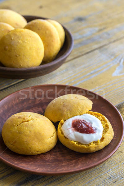 Pumpkin scones with cream and fruit jam Stock photo © Alex9500