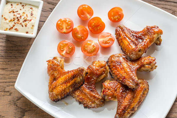 Baked chicken wings with spicy sauce Stock photo © Alex9500