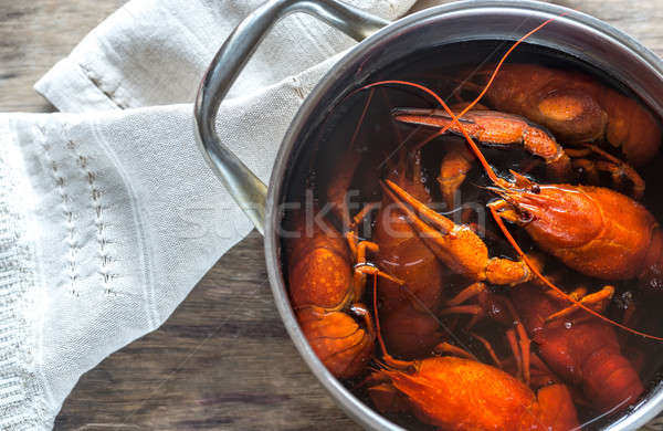 Pot with boiled crayfish on the wooden table Stock photo © Alex9500