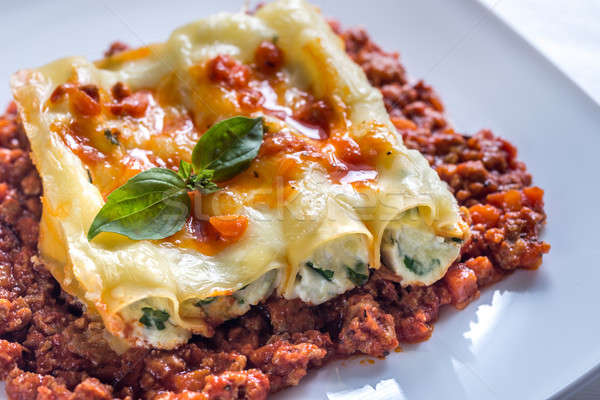 Canelloni stuffed with ricotta with bolognese sauce Stock photo © Alex9500
