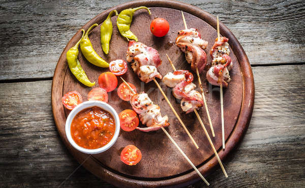 Grilled bacon skewers with chicken, peppers and cherry tomatoes Stock photo © Alex9500