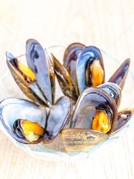 Bowl of mussels on the wooden table Stock photo © Alex9500