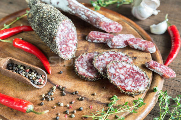 Slices of saucisson and fuet on the wooden board Stock photo © Alex9500