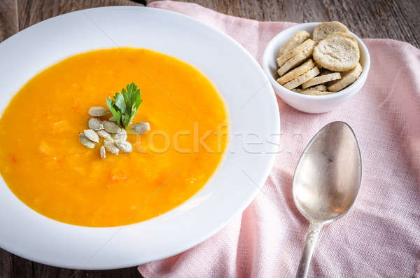 Portion of pumpkin cream soup on the wooden table Stock photo © Alex9500