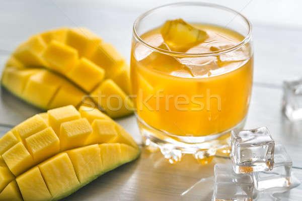 Mango juice on the wooden table Stock photo © Alex9500