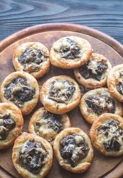 Tartelettes with shiitake mushrooms and cheese Stock photo © Alex9500