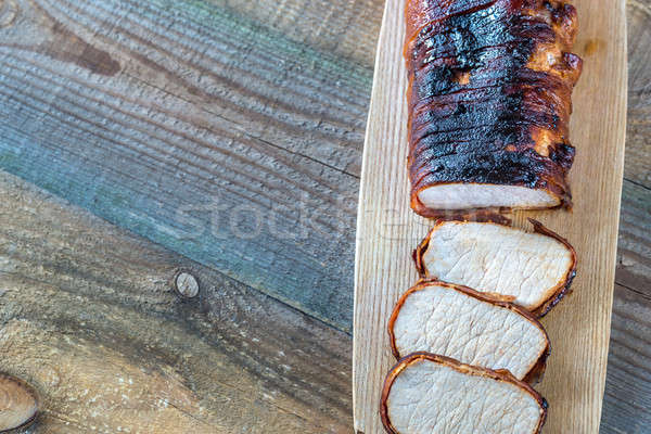 Pork loin wrapped in bacon on the wooden board Stock photo © Alex9500