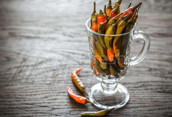 Marinált paprikák üveg konyha narancs asztal Stock fotó © Alex9500